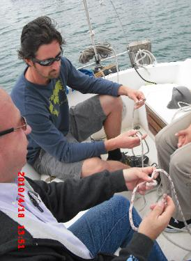 Randle Moore (front) instructing Walt and Heather how to tie the bowline.