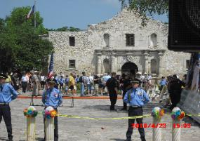 Front of the Alamo as seen from the Battle of Flowers Review Stand. San Antonio Academy Cadets serving as honor guard.